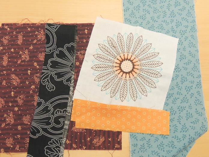 The trimmed embroidery design with selection of fall fabrics