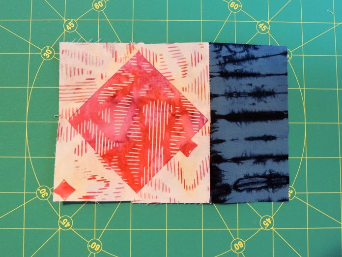 Fabric E strip added to a square in a square unit.