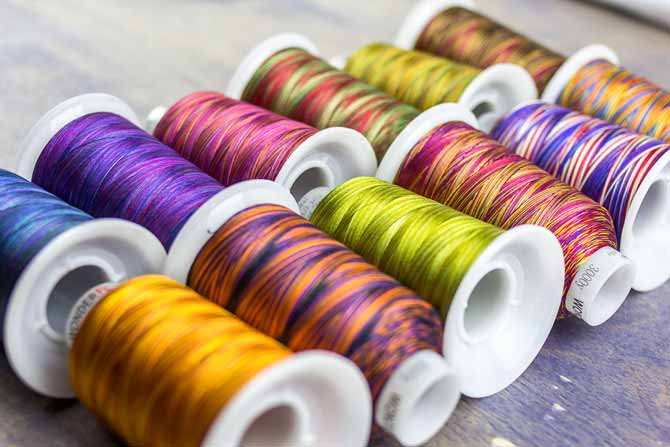 In the Fabulux thread shades of 2 - 3 colors enhance movement in quilting.
