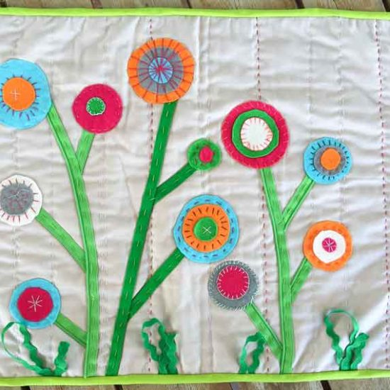 Hand made table runner with wool felt, embroidery thread and zippers.