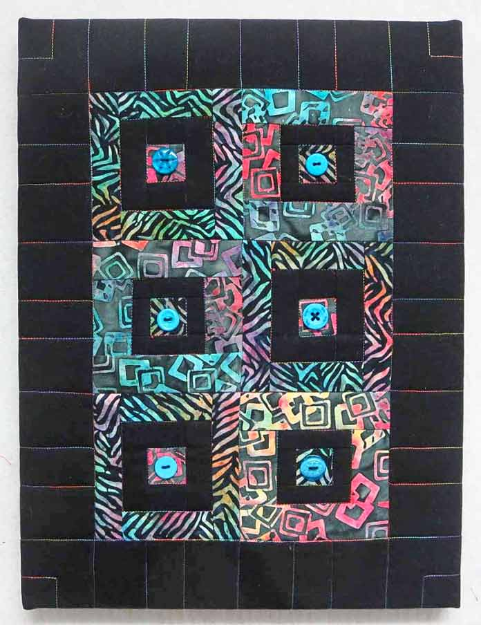 "Button quilt mounted on a 12"" x 16"" artist canvas"