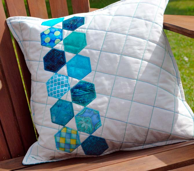 Finished hexagon quilted back porch pillow.