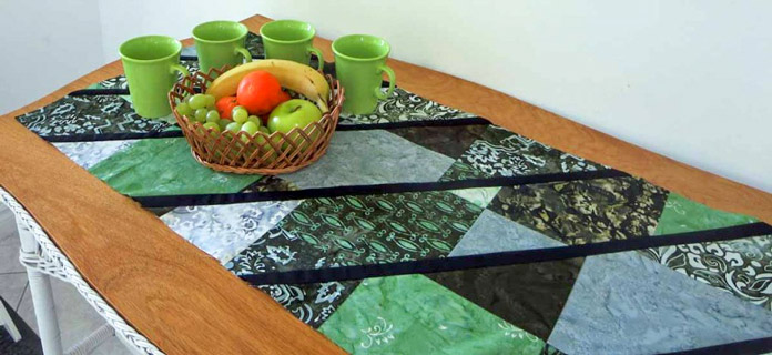 2 disappearing 9 patch blocks make 1 modern table runner