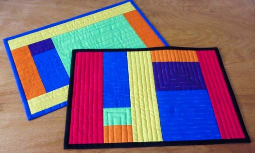 Modern place mats with solid-color binding