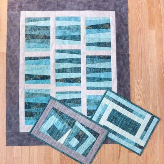 Quilt top and placemats made with Northcott's Artisan Spirit Shimmer, Artisan Spirit Echoes, and Toscana fabrics.
