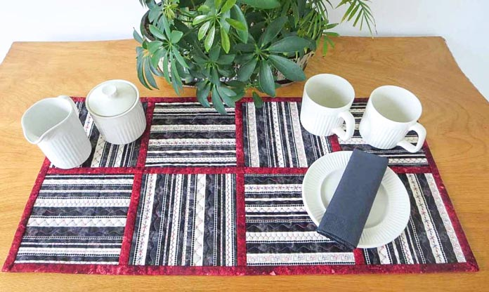 Finished table runner with decorative stitching on striped fabric
