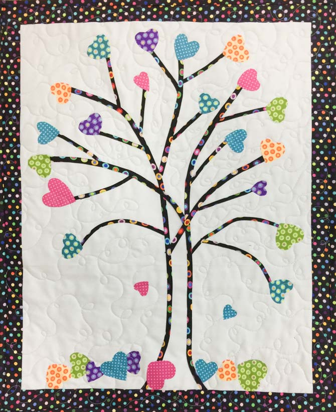 Quilted tree made with bias tape for branches and hearts for leaves.