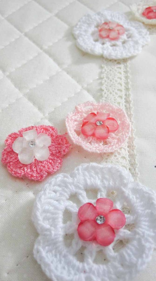 Mini doilies and pretty buttons make this wall quilt shout hello to spring!