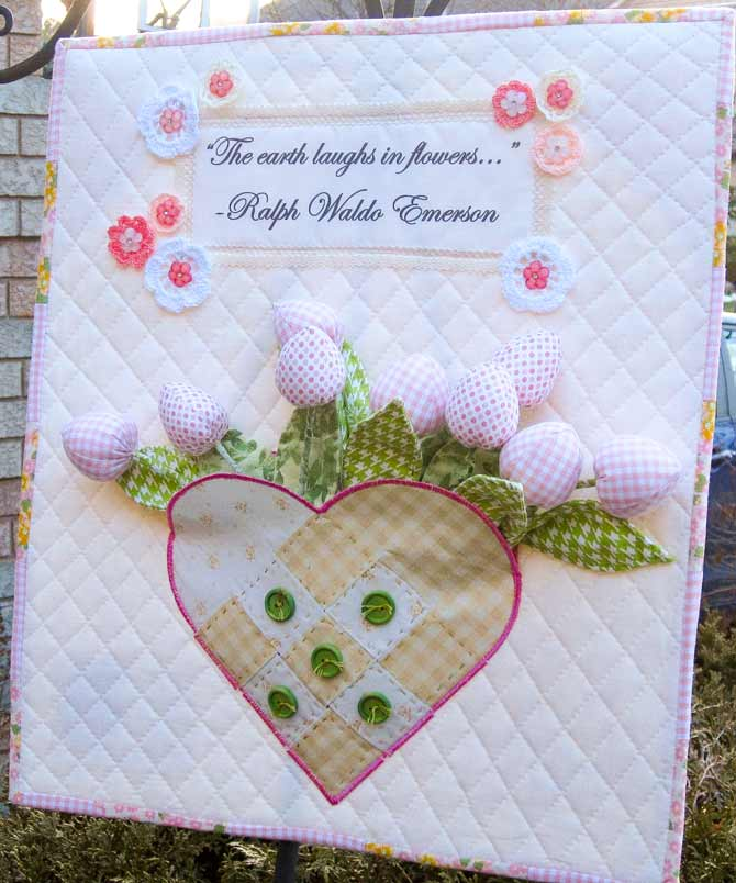 Our Laughing Flowers Wall Quilt cheers up a sleeping garden.