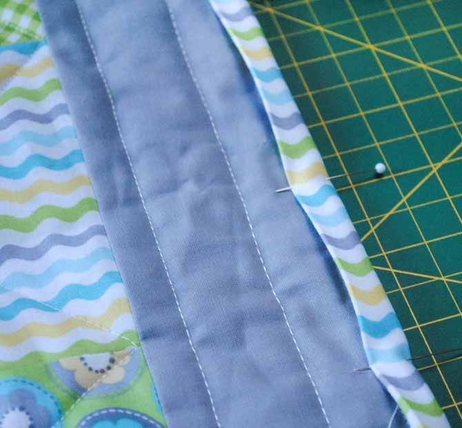 The binding is sewn to the back of the baby quilt and then folded to the front so that the Brother NQ900's decorative stitches can be used to stitch it down.