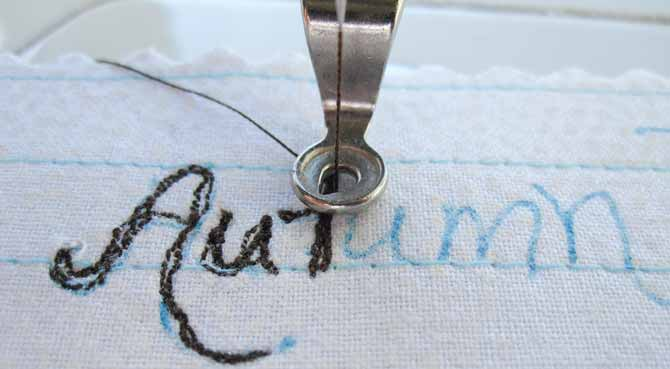 Set up your machine for free motion quilting, and then stitch on the drawn lines to create an embroidered quilt label.
