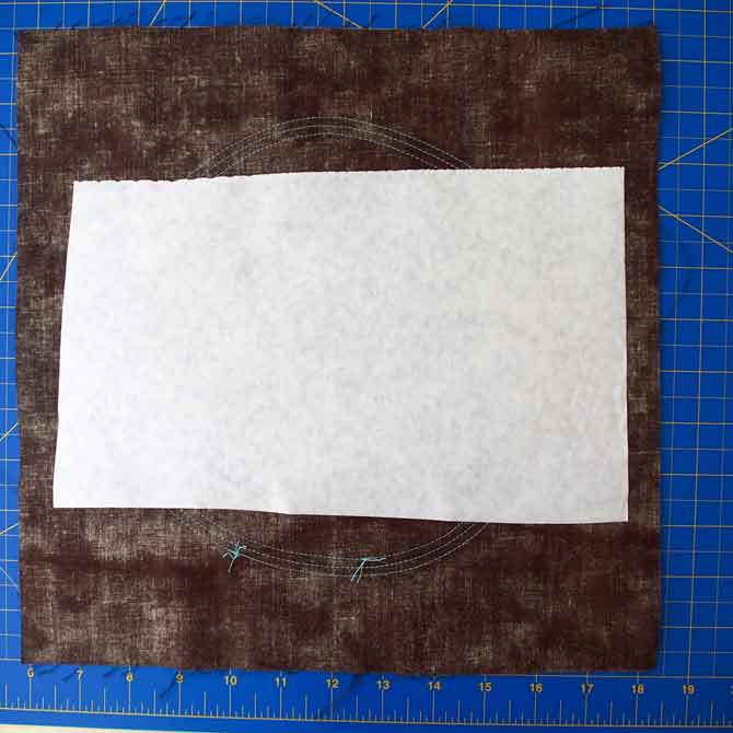 Freezer paper on back of block for stability