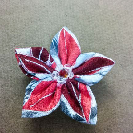 Fussy-cut poinsettia fabric flower