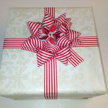 Gift with bow and fabric flower