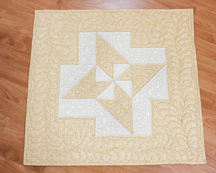 Use WonderFil's metallic thread, Spotlite for beautiful stitching and shiny thread that makes this quilt sparkle.