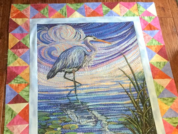 Good preparation is the key to success when adding pieced borders to a printed panel. A tutorial on thread painting using SCHMETZ needles/ Gütermann threads / Northcott fabric