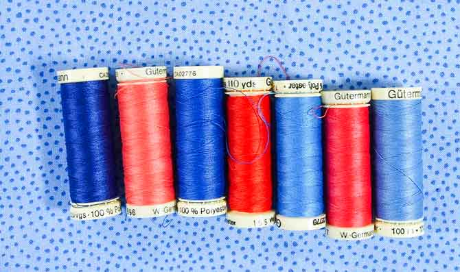 A variety of blue and orange Gütermann thread