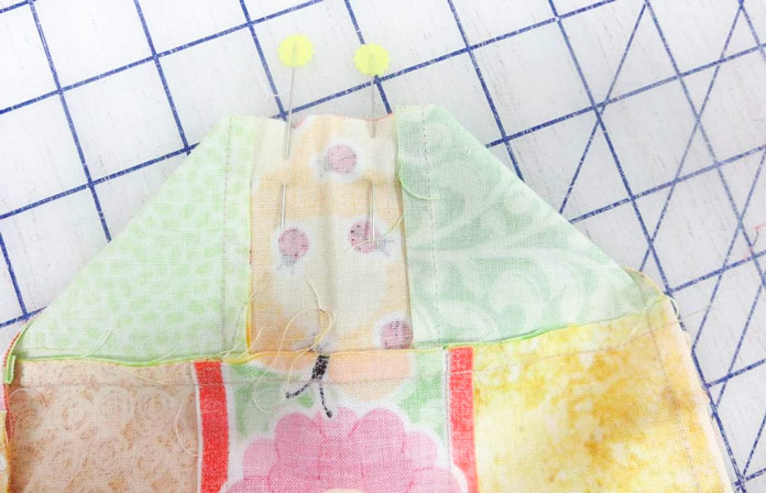 Fold bag, right sides together, and stitch to make the bottom corners.