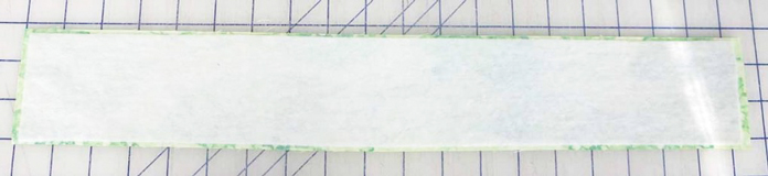 Press HeatnBond fusible fleece to wrong side of handles