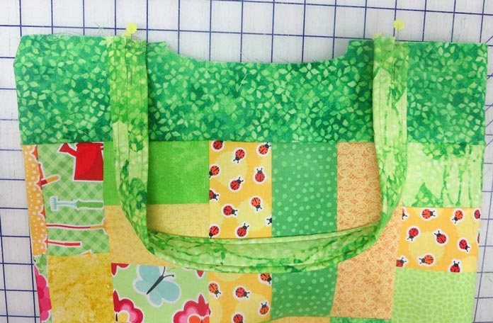 Sew the handles to the outer bag.