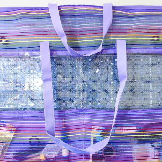 Purple mesh tool tote with handles falling down the front