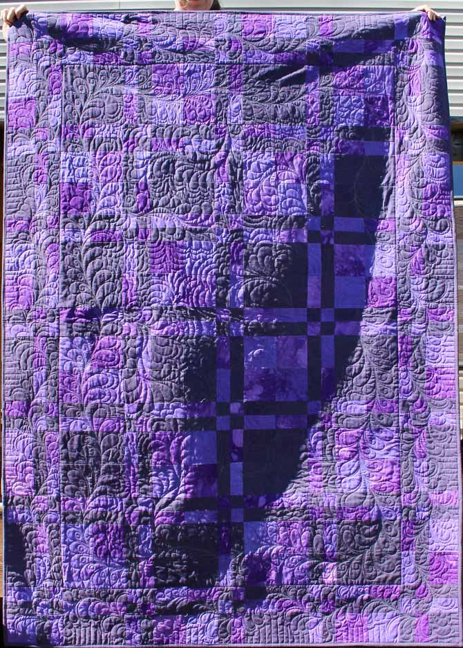 The texture of the quilting in Marina's quilt shows up so well when it's outside in the sun.