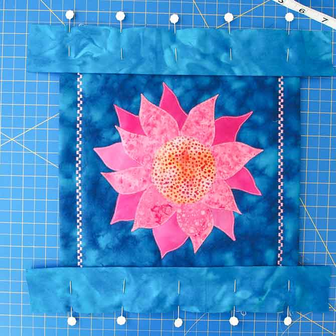 Horizontal pieces pinned to quilt