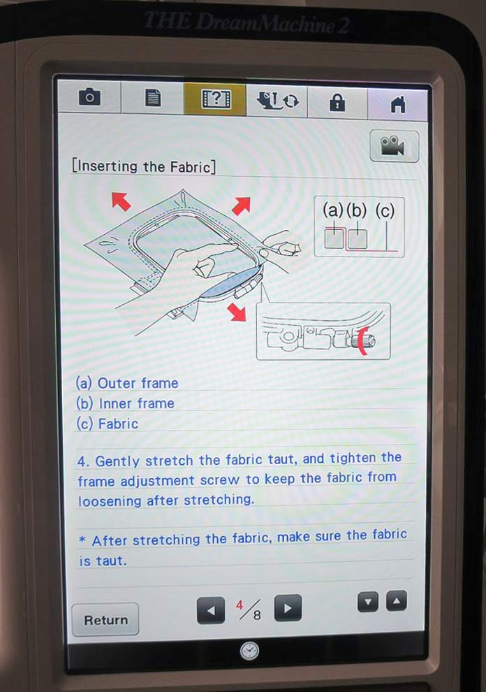 Help screen showing how to hoop the fabric