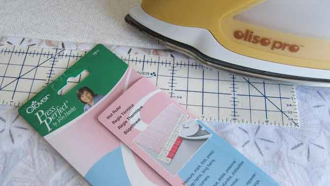 The Press Perfect hot ruler makes quick work of pressing a hem on to the edge of the backing.