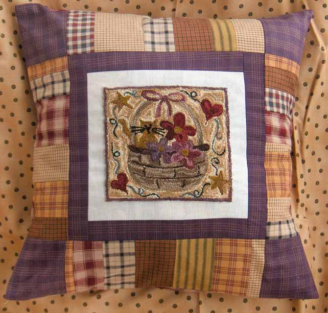 Allie's Basket punchneedle pattern by Christine Baker of Fairfield Road Designs, sewn into a pillow.