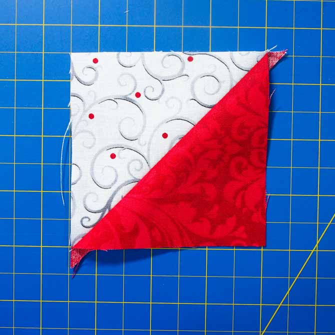 One 3 ½″ half square triangle