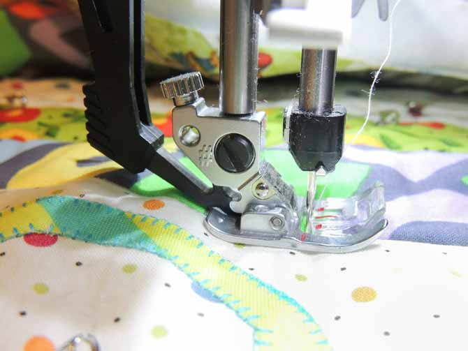 The IDT system on the creative 3.0 works with several different presser feet to feed all layers of material under the needle evenly. Good bye puckers!