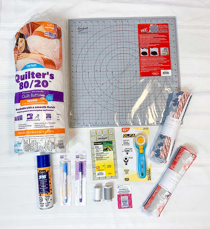 Materials needed to make a Half Rectangle Triangle table runner. UNIQUE sewing Fast Fade Fabric Markers, Gütermann Thread, SCHMETZ Quilting Needles, Fairfield Quilter's 80/20 Batting, Odif 505 Temporary Quilt Basting Adhesive Fabric Spray, Omnigrid rulers, Olfa Rotary Cutter, Komfort KUT Rotary Cutting Mat, Fabric Creations cotton fabric