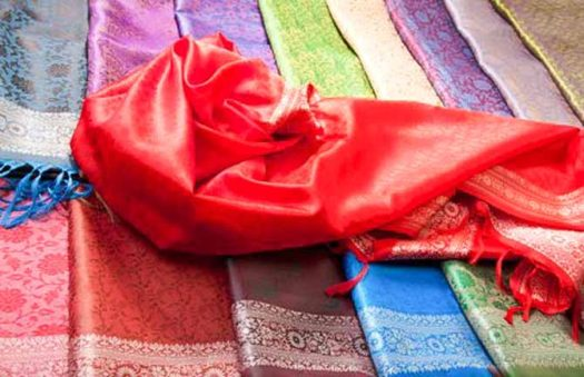 a selection of silk pashminas and wraps