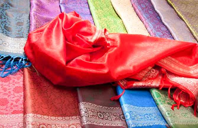 a selection of silk pashminas and wraps
