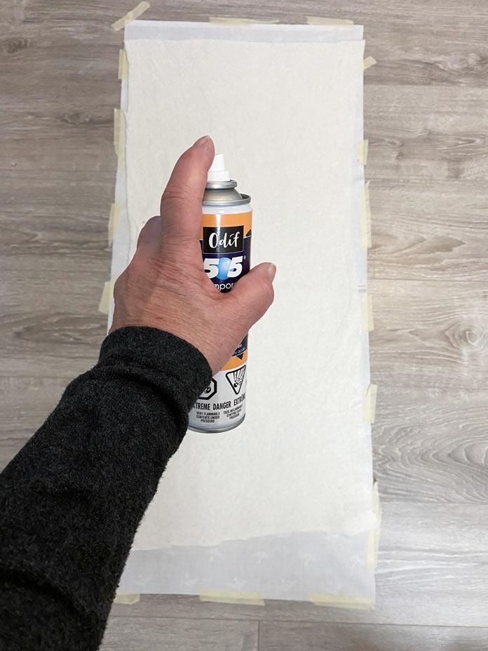 The batting layer is sprayed with quilt basting spray. Gütermann Cotton Thread, Fabric Creations Cotton Fabric, Odif 505 Temporary Quilt Basting Adhesive Spray, Fairfield Quilter's 80/20 Quilt Batting, SCHMETZ Machine Quilting Needles