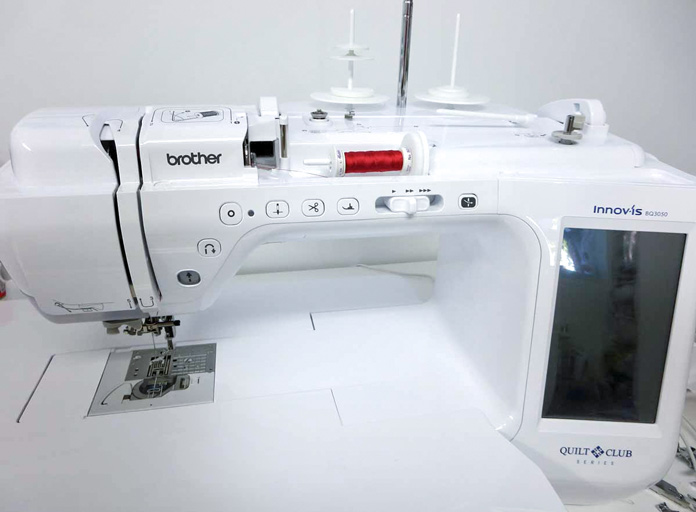 Brother Innov-ís BQ3050 sewing and quilting machine. Brother Innov-ís BQ3050 sewing and quilting machine, Brother SA186 Metal Open-Toe Foot, Brother SA204C Dual-Feed Stitch-in-the-Ditch Foot, Brother SA195 MuVit Open-Toe Dual-Feed Foot