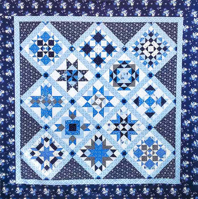 A blue and white quilt top. Spectrum QAL2020 made with the Blue Stitch collection by Riley Blake Designs