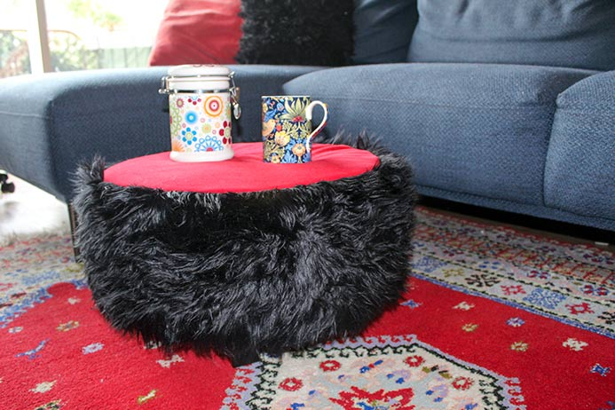 The Shabby Tuffet made using the Fairfield Foamology Soft Support Foam Tuffet Kit is shown in an Arabian Nights styled living room.