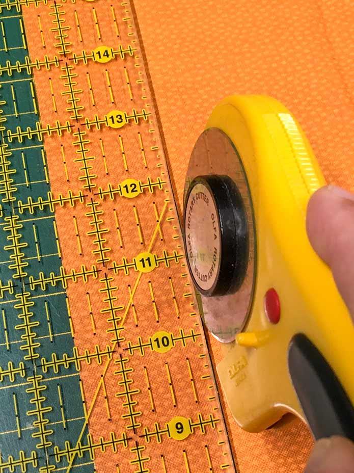 """Cut 6 border strips 1½"""" wide. Omnigrid 6"""" x 24"""" ruler, Olfa 45mm rotary cutter"""