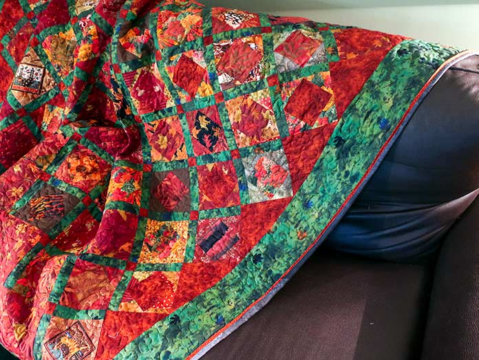 A completed quilt is shown with a flange.