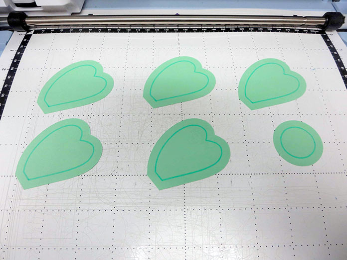 Fabric pieces cut out with drawn seam line. Brother ScanNCut SDX225, Brother fabric mat, Brother blue erasable marking pen, Brother color pen set
