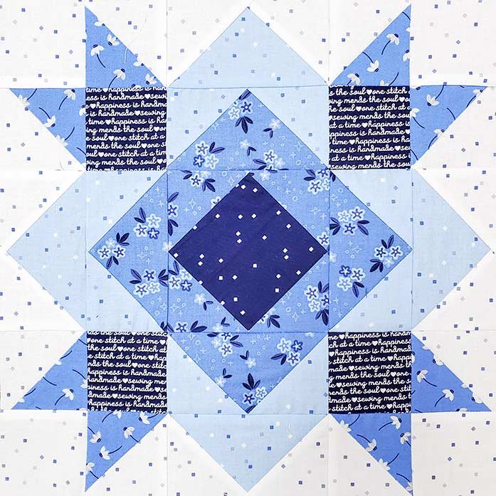 A blue and white quilt block made with the Block 9 of the Spectrum QAL 2020 made with Riley Blake Designs Blue Stitch collection