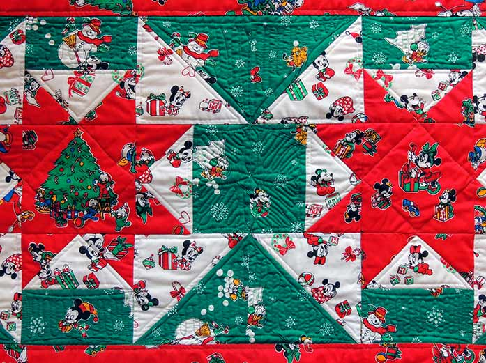 Free-motion quilting holiday bed runner background quilting PFAFF performance icon project