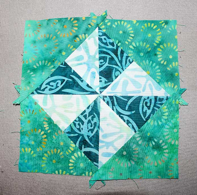 """ake the other two E triangles and stitch on the last opposite edges of Step 3 square, ensuring that point of triangles are aligned with the center of block. Makes a 6½"""" square."""
