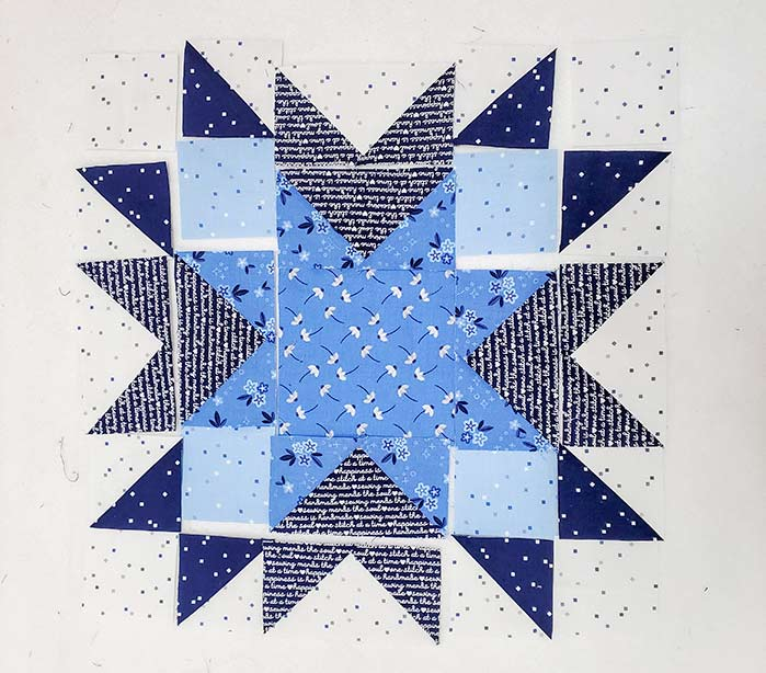 A blue and white quilt block ready to sew