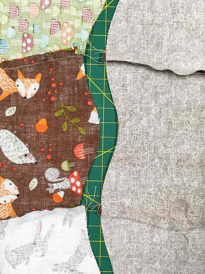 The seams in the rows are pressed in opposite directions so that they will match together nicely when they are sewn.