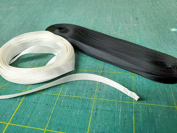 "White and black ¼"" polyester ribbon"