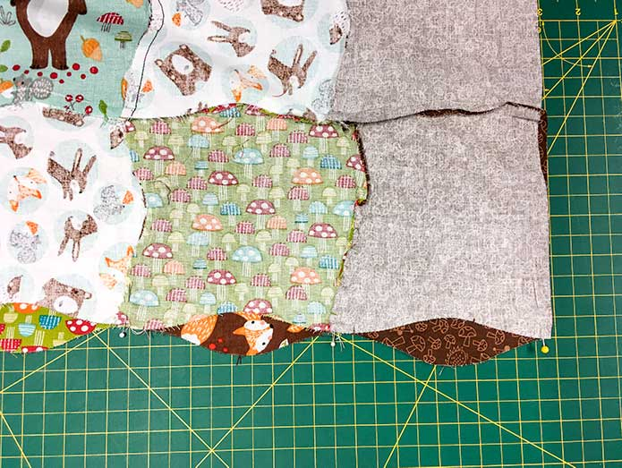 The rows of the quilt are pinned together so that the curved seams match up.
