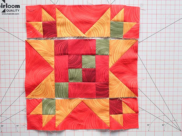 The rows are placed in their correct positions according to the design layout diagram before they are sewn together.